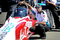 Jul. 17, 2010; Sonoma, CA, USA; NHRA top fuel dragster driver Rod Fuller sits in his car with Rashed al Quibisi alongside during qualifying for the Fram Autolite Nationals at Infineon Raceway. Mandatory Credit: Mark J. Rebilas-