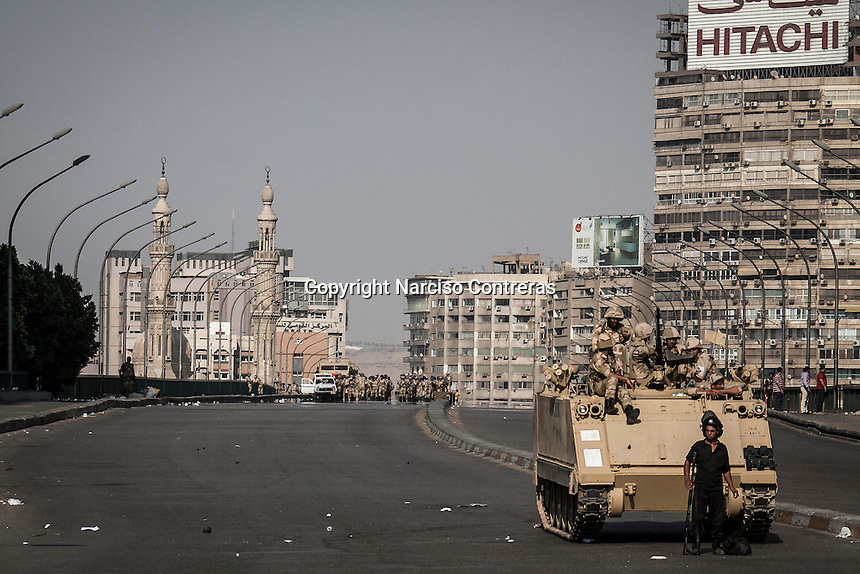 In this Thursday, Jul. 04, 2013 photo, the military stand at one of the streets to the University of Cairo in Giza district where the Muslim Brotherhood gather during a 24/7 rally against the coup that has left many of its leaders in prison, Cairo, Egypt. (Photo/Narciso Contreras).