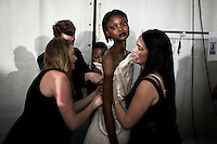 JOHANNESBURG, SOUTH AFRICA MARCH 7: Favour Lucky, a fifteen year old Nigerian model gets dressed backstage at Mercedes Benz Africa fashion week on March 7, 2013 held in Johannesburg, South Africa. Designers from around South Africa showed their best fall/winter collections. Favour won Nigeria's next supermodel contest when she was fourteen years old. Photo by: Per-Anders Pettersson)