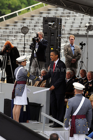 U.S. President Barack Obama greets a member of the graduating class during graduation ceremonies at the United States Military Academy at West Point  in West Point, New York. May 22, 2010.Credit: Dennis Van Tine/MediaPunch