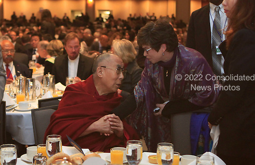 Valerie Jarrett  talks to the Dalai Lama as United States President Barack Obama attends the National Prayer Breakfast at the Washington Hilton Hotel in Washington, D.C. on February 5, 2015.  U.S. and international leaders from different parties and religions gather annually at this event for an hour devoted to faith and prayer.<br /> Credit: Dennis Brack / Pool via CNP