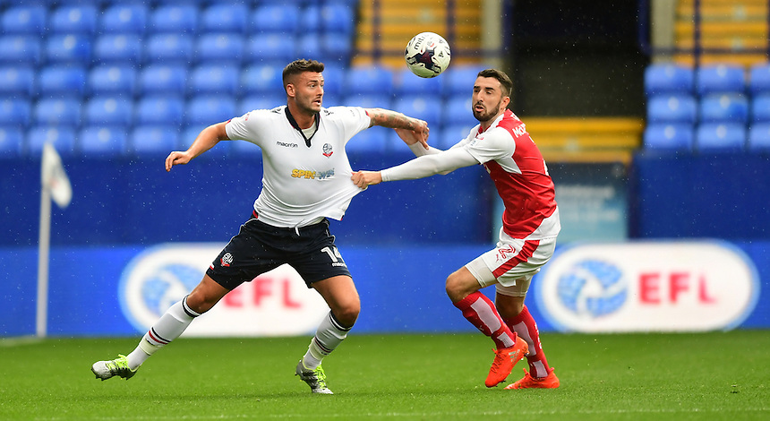 Bolton Wanderers's Gary Madine shields the ball from Fleetwood Town's Conor McLaughlin<br /> <br /> Photographer Chris Vaughan/CameraSport<br /> <br /> Football - The EFL Sky Bet League One - Bolton Wanderers v Fleetwood Town - Saturday 20 August 2016 - Macron Stadium - Bolton<br /> <br /> World Copyright &copy; 2016 CameraSport. All rights reserved. 43 Linden Ave. Countesthorpe. Leicester. England. LE8 5PG - Tel: +44 (0) 116 277 4147 - admin@camerasport.com - www.camerasport.com