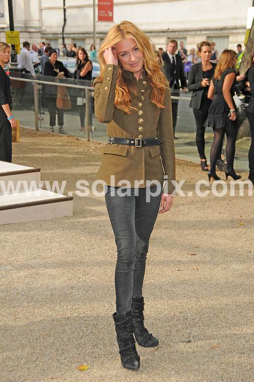 **ALL ROUND PICTURES FROM SOLARPIX.COM**                                             **WORLDWIDE SYNDICATION RIGHTS**                                                                                  Caption: The Burberry 2011 catwalk show as part of London Fashion Week at Chelsea College of Art and Design, London, UK. 21 September 2010                                                                              This pic: Cat Deeley                                                                                          JOB REF: 12162 MSR       DATE: 21_09_2010                                                           **MUST CREDIT SOLARPIX.COM OR DOUBLE FEE WILL BE CHARGED**                                                                      **MUST AGREE FEE BEFORE ONLINE USAGE**                               **CALL US ON: +34 952 811 768 or LOW RATE FROM UK 0844 617 7637**