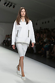 London, UK. 13 September 2014. A model walks the runway at the Jasper Conran show at London Fashion Week SS15 at the BFC Courtyard Show Space in London, England. Photo: CatwalkFashion/Alamy Live News