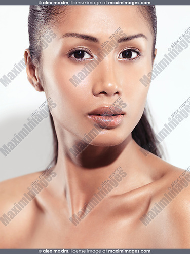 Sensual closeup beauty portrait of a young woman beautiful exotic face pacific islander with healthy natural look isolated on white background
