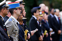A French soldier and diplomats take part in the Remembrance Sunday ceremony at the Hodogaya, Commonwealth War Graves Cemetery in Hodogaya, Yokohama, Kanagawa, Japan. Sunday November 12th 2017. The Hodagaya Cemetery holds the remains of more than 1500 servicemen and women, from the Commonwealth but also from Holland and the United States, who died as prisoners of war or during the Allied occupation of Japan. Each year officials from the British and Commonwealth embassies, the British Legion and the British Chamber of Commerce honour the dead at a ceremony in this beautiful cemetery.