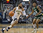 Nevada's Cody Martin drives against Colorado State's Prentiss Nixon in the first half of an NCAA college basketball game in Reno, Nev., Sunday, Feb. 25, 2018. (AP Photo/Tom R. Smedes)