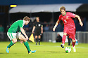 Portugal's Fabio Coentrao taclkes Northern Ireland's Lee Hodson during a World Cup Qualifier in Belfast, Friday September 6th, 2013.  Photo/Paul McErlane