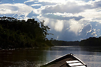 A boat travels down the Tambopata River in Peruís Amazon Jungle.