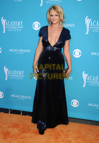 MIRANDA LAMBERT .Arrivals - 45th Annual Academy Of Country Music Awards held at the MGM Grand Garden Arena, Las Vegas, NV, USA, 18th April 2010..ACM ACMs full length long maxi  blue dress cleavage boobs low cut sequined sequin navy plunging neckline clutch bag .CAP/ADM/BP.©Byron Purvis/AdMedia/Capital Pictures.