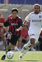 The MetroStars' Joselito Vaca is trailed by he Earthquake's Dwayne De Rosario. The San Jose Earthquakes were shut out by  the NY/NJ MetroStars 2-0 at Giant's Stadium, East Rutherford, NJ, on July 10, 2004.