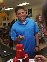 NWA Democrat-Gazette/FLIP PUTTHOFF <br /> Ryan Quintana, world history and science teacher at Lingle Middle School in Rogers, works Friday Sept. 23 2016 with students during a science class.