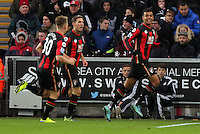 Joshua King of Bournemouth (R) celebrates his opening goal with team mates during the Barclays Premier League match between Swansea City and Bournemouth at the Liberty Stadium, Swansea on November 21 2015