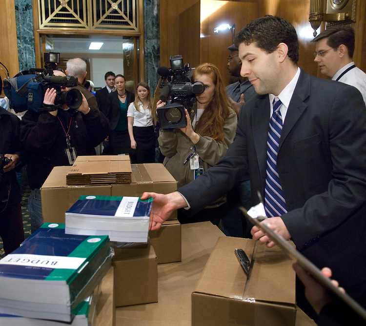 WASHINGTON, DC - Feb 04: Senate Budget Committee aide Andrew Kermick unpacks copies of President Bush's fiscal 2009 budget request during a photo op in the Senate Budget Committee meeting room, where Senate staff come to pick up their copies. The $3.1 trillion fiscal 2009 budget proposal, released today, represents Bush's last chance to put his imprint of the nation's fiscal landscape. But with Democrats controlling Congress and hoping to win the presidency in November, Bush's budget has little chance of being enacted. (Photo by Scott J. Ferrell/Congressional Quarterly)