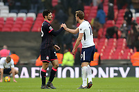 Christopher Schindler of Huddersfield Town and Harry Kane of Tottenham Hotspur after Tottenham Hotspur vs Huddersfield Town, Premier League Football at Wembley Stadium on 3rd March 2018