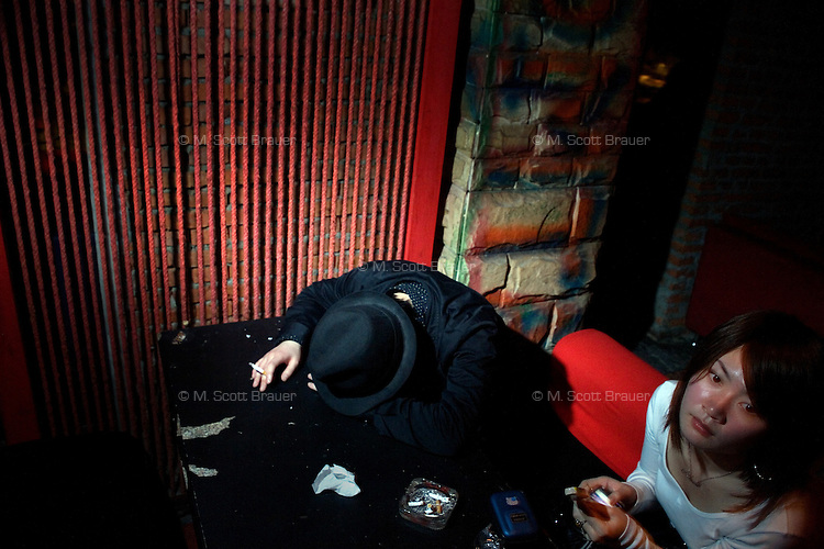 Punk fans rest in a quiet area of Castle Bar during a punk concert in Nanjing, China.