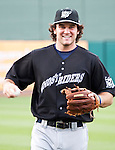 """Reno's Ryan Wheeler warms up as the Aces are transformed into the Reno Ghost Riders for the """"What Could Have Been Weekend"""" series against the Salt Lake Bees on Thursday night July 12, 2012 at Aces Ballpark in Reno, NV."""