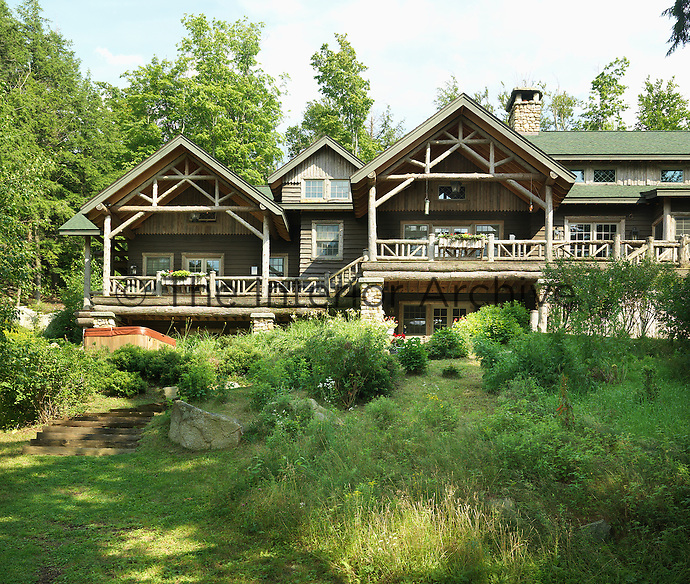 This spectacular log cabin has two open porches with views down to the lake
