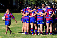 The Richmond team huddle before the Auckland Rugby League Girls Pilot under-17 match between Otara Scorpions and Richmond at Ngati Otara Park in Auckland, New Zealand on Saturday, 9 June 2018. Photo: Dave Lintott / lintottphoto.co.nz