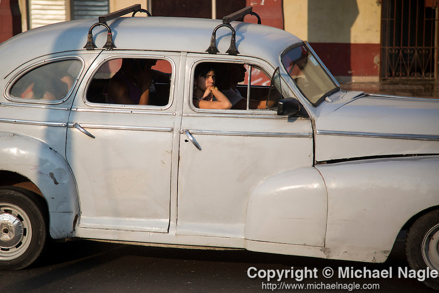 HAVANA, CUBA -- MARCH 25, 2015:   People ride in a taxi in Havana, Cuba on March 25, 2015. Photograph by Michael Nagle