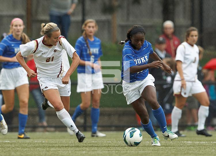 Duke University midfielder Toni Payne (10) on the attack as Boston College midfielder Kate McCarthy (21) closes.Boston College (white) defeated Duke University (blue/white), 4-1, at Newton Campus Field, on October 6, 2013.