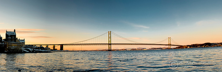 Image of the Forth Road Bridge at dusk, Edinburgh, UK, Europe. The Bridge connects the city of Edinburgh to Fife, crossing the Firth of Forth (fjord).