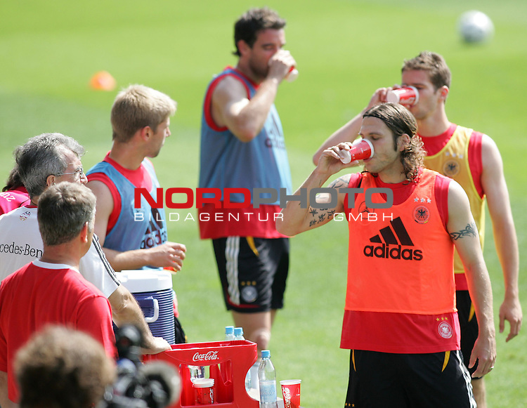 FIFA WM 2006 - Training - Germany<br /> Christoph Metzelder, Torsten Frings and Arne Friedrich (l-r) refreshing with water during a training session at the World Cup in Berlin (Stadion Wurfplatz). <br /> Foto &copy; nordphoto