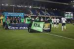 The players walking on to the pitch past young people with anti-racism 'Kick It Out' banners on the pitch at Goodison Park, Liverpool before the Premier League match between Everton and West Bromwich Albion. The match ended in a 0-0 draw, despite the home team missing a first-half penalty by Kevin Mirallas. The game was watched by 34,739 spectators and left both teams languishing near the relegation zone.