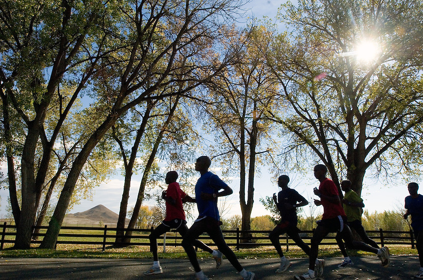 A training group of Kenyan runners passes Haystack Mountain, left, on a 30-kilometer training run. Boulder, Colo. is a mecca for runners due to a variety of terrain and altitudes available for training. (Kevin Moloney for the New York Times)
