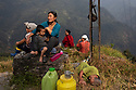 India - Sikkim - Farmers take a lunch break after a morning spent in the paddy fiels.
