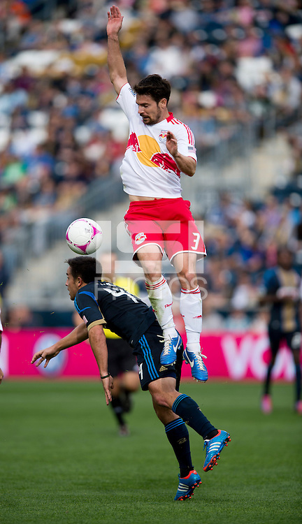 Heath Pearce (3) of the New York Red Bulls collides with Danny Cruz (44) of the Philadelphia Union during the game at PPL Park in Chester, PA.  New York defeated Philadelphia, 3-0.