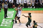 MILWAUKEE, WI - MARCH 16:  Purdue Boilermakers forward Vince Edwards (12) makes a mid-air pass along the baseline during the second half of the 2017 NCAA Men's Basketball Tournament held at BMO Harris Bradley Center on March 16, 2017 in Milwaukee, Wisconsin. (Photo by Jamie Schwaberow/NCAA Photos via Getty Images)