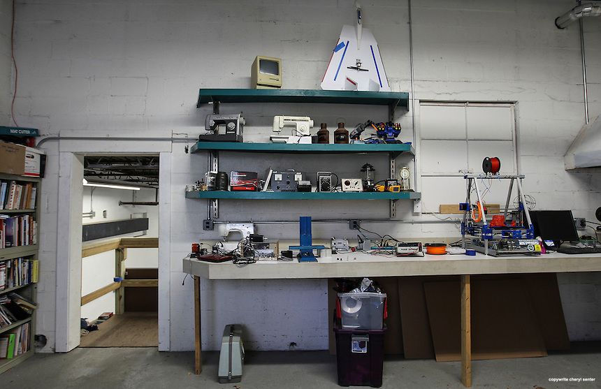 Portsmouth, N.H. -  Tuesday, Nov. 12, 2013:  An eclectic collection of working tools and whimsy on shelving in the computer related workroom section at Port City Maker Space.  CREDIT: Cheryl Senter for the New Hampshire Business Review