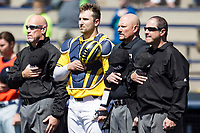 Michigan Wolverines catcher Harrison Wenson (7) stands with umpires Sal Giacomantonio, Mike Martin and Scott Inman during the national anthem before the NCAA baseball game against the Illinois Fighting Illini on April 8, 2017 at Ray Fisher Stadium in Ann Arbor, Michigan. Michigan defeated Illinois 7-0. (Andrew Woolley/Four Seam Images)