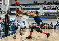 WASHINGTON, DC - JANUARY 29: Armel Potter #2 of George Washington pulls the ball back from Kellan Grady #31 of Davidson during a game between Davidson and George Wshington at Charles E Smith Center on January 29, 2020 in Washington, DC.