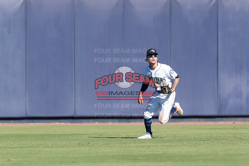 Peoria Javelinas center fielder Ian Miller (9), of the Seattle Mariners organization, pursues a fly ball during an Arizona Fall League game against the Scottsdale Scorpions at Peoria Sports Complex on October 18, 2018 in Peoria, Arizona. Scottsdale defeated Peoria 8-0. (Zachary Lucy/Four Seam Images)