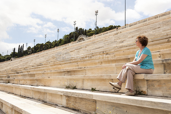 Tourist sitting on seats in the Panathenaic Stadium, original modern day Olympic Stadium, Athens, Greece <br /> CAP/MEL<br /> &copy;MEL/Capital Pictures /MediaPunch ***NORTH AND SOUTH AMERICA ONLY***