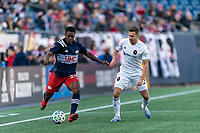 FOXBOROUGH, MA - MARCH 7: DeJuan Jones #24 of New England Revolution passes the ball as Przemyslaw Frankowski #11 of Chicago Fire defends during a game between Chicago Fire and New England Revolution at Gillette Stadium on March 7, 2020 in Foxborough, Massachusetts.