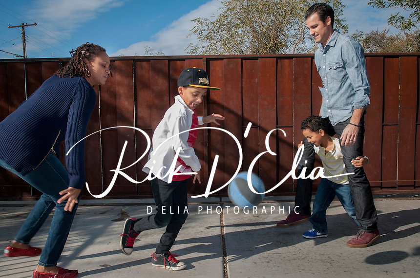 Kristina and Nicholas Krump and their boys, Ellis, 7 and Evan, 5 at their Phoenix home.