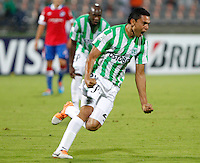 MEDELLÍN -COLOMBIA-11-03-2014. Daniel Bocanegra de Atlético Nacional de Colombia celebra un gol anotado a Nacional de Uruguay durante el partido de la segunda fase, grupo 6 de la Copa Libertadores de América en el estadio Atanasio Girardot en Medellín, Colombia./ Daniel Bocanegra player of Atletico Nacional of Colombia celebrates a goal scored to Nacional of Uruguay during macth of the second phase, group 6 of the Copa Libertadores championship played at Atanasio Girardot stadium in Medellin, Colombia. Photo: VizzorImage/ Luis Ríos /STR