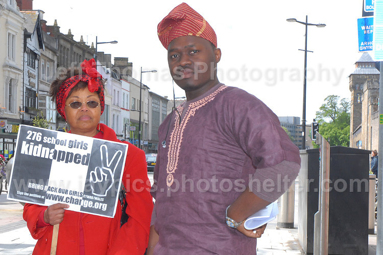 2 rally supporters. <br /> <br /> Cardiff, South Wales. Sunday May 11th 2014. Nigerians in Cardiff in organised rally in support of the 276 abducted school children in Chibok, Nigeria by Boko Haram terrorists. <br /> <br /> Photo by Jeff Thomas/Jeff Thomas Photography