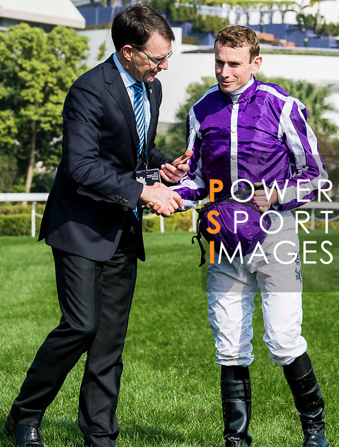 Jockey Ryan Moore celebrates with trainer Aidan Patrick O'Brien after winning the Longines Hong Kong Vase (G1, 2400m) on Highland Reel during the Longines Hong Kong International Races at Sha Tin Racecourse on December 10 2017, in Hong Kong, Hong Kong. Photo by Victor Fraile / Power Sport Images
