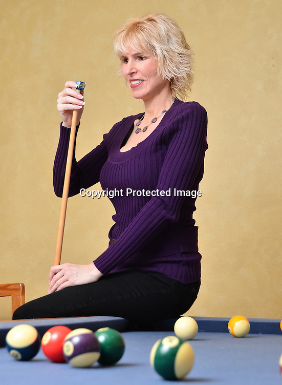 Royalty free stock photos of Woman playing pool