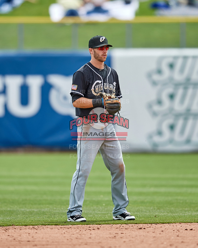Dusty Coleman (15) of the El Paso Chihuahuas on defense against the Salt Lake Bees in Pacific Coast League action at Smith's Ballpark on April 30, 2017 in Salt Lake City, Utah.   El Paso defeated Salt Lake 3-0. This was Game 1 of a double-header. (Stephen Smith/Four Seam Images)