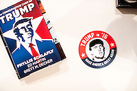 """A copy of Phyllis Schlafly's book """"The Conservative Case for Trump"""" and a Trump campaign sticker lay on a desk in John Paul Moran's live/work studio in Boston, Massachusetts. Moran is a Trump supporter who will be traveling to Washington DC to attend the inauguration and associated events as Donald Trump is sworn in as president of the United States. Moran volunteered with the Trump campaign in Massachusetts and helped organize rallies around his """"#HerLiesMatter"""" campaign."""