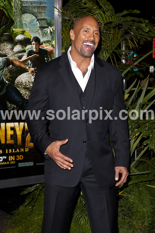 """**ALL ROUND PICTURES FROM SOLARPIX.COM**                                             **SYNDICATION RIGHTS FOR UK, AUSTRALIA, DENMARK, PORTUGAL, S. AFRICA, SPAIN & DUBAI (U.A.E) & ASIA (EXCLUDING JAPAN) ONLY**                                                                                  Caption: Journey 2: The Mysterious Island"""" Premiere   held at The Grauman's Chinese Theatre - Hollywood, Los Angeles CA, USA                                                                               This pic: Dwayne Johnson                                                                                        JOB REF: 14415       PHZ       DATE: 02.02.2012                                                           **MUST CREDIT SOLARPIX.COM OR DOUBLE FEE WILL BE CHARGED**                                                                      **MUST AGREE FEE BEFORE ONLINE USAGE**                               **CALL US ON: +34 952 811 768 or LOW RATE FROM UK 0844 617 7637**"""