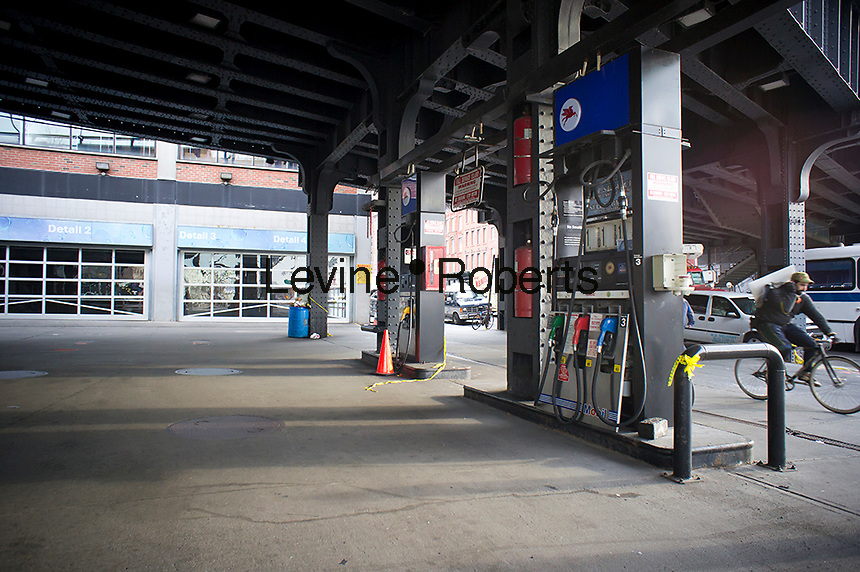 The closed Exxon Mobil station in West Chelsea in New York is seen on Wednesday, January 11, 2012. The long-time fixture in the West Chelsea neighborhood, conveniently located just off of West Street, has closed. The station, which sits directly under the trendy High Line Park is a victim of the rising real estate values of the area.(© Richard B. Levine)