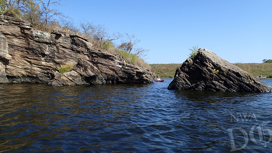 NWA Democrat-Gazette/FLIP PUTTHOFF<br />Weaving among cliffs and boulders      Oct. 13 2017      is one of the joys of paddling at Lincoln Lake.
