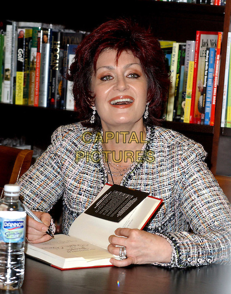 "SHARON OSBOURNE.signs the Osbourne family's new book ""Ordinary People: Our Story"" at the Barnes & Noble at The Grove at .Farmers Market in Los Angeles, California.19 February 2004                                                                                                                              *UK Sales Only*.laughing.www.capitalpictures.com.sales@capitalpictures.com.©Capital Pictures."
