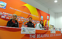 Coach Pia Sundhage, Abby Wambach and Carli Lloyd (left to right) of team USA at a press conference during the FIFA Women's World Cup at FIFA Stadium in Dresden, Germany on July 9th, 2011.